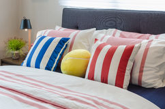 Modern bedroom with colorful pillows on bed and modern black lam Stock Images
