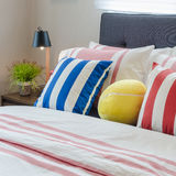 Modern bedroom with colorful pillows on bed and modern black lam Royalty Free Stock Photos