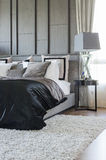 Modern bedroom design in black and white color scheme with moder Royalty Free Stock Photo