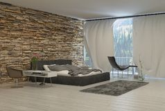 Modern Bedroom with Exposed Brick Wall. Bedroom with Modern Furnishings and Exposed Brick Wall and View of Forest from Balcony Stock Photo