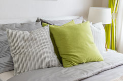Modern bedroom with green pillow on bed Stock Photos