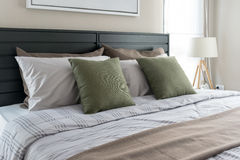 Modern bedroom with green pillows Royalty Free Stock Photo
