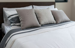 Modern bedroom with grey pillows Royalty Free Stock Photo