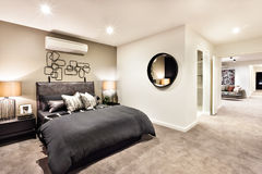 Modern bedroom with a hallway to other rooms Royalty Free Stock Image