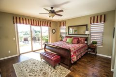 Modern Bedroom With Hardwood Floors. Modern Bedroom With Rich Hardwood Flooring & Access To Exterior stock photos