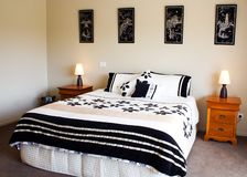 Modern Bedroom Interior. A beautiful modern bedroom interior including bed and furniture Royalty Free Stock Photos
