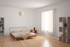 Modern Bedroom Interior. With minimalistic furnishing in neutral colours on an uncarpeted hardwood floor Royalty Free Stock Photography