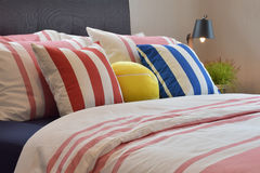 Modern bedroom interior with colorful pillows Royalty Free Stock Photos