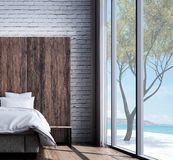 The modern bedroom interior design and brick wall texture background and sea view. 3d rendering interior design concept idea of bedroom Royalty Free Stock Photography