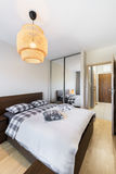 Modern bedroom interior design. In wooden finish Royalty Free Stock Photos