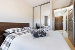Modern bedroom interior design. In wooden finish Stock Image