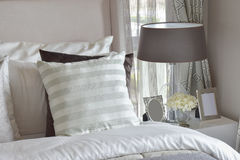 Modern bedroom interior with green striped pillow on bed Royalty Free Stock Images
