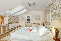 Modern bedroom interior in light beige colors Royalty Free Stock Image