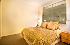 Modern bedroom interior in a luxurious apartment with king size Royalty Free Stock Photos