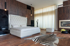 Modern bedroom interior. Luxurious interior of modern contemporary house Royalty Free Stock Photos