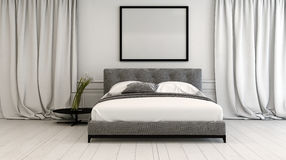 Modern bedroom interior in neutral tones. With a double divan style bed between long floor length drapes on a white painted parquet floor, blank picture frame Stock Photos