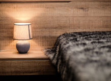 Modern bedroom with  light and fur blanket Stock Photo