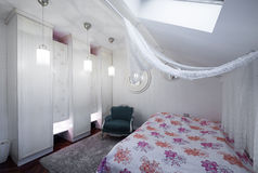 Modern bedroom in loft apartment Royalty Free Stock Images