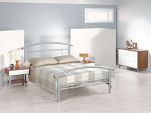 Modern bedroom with metal furniture Stock Image