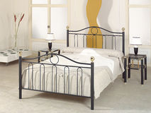 Modern bedroom with metal furniture Stock Images