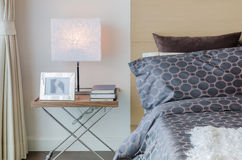 Modern bedroom with modern lamp Stock Photography