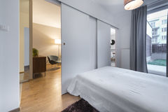 Modern bedroom in new apartment Stock Photos