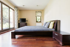 Modern bedroom with panorama windows Stock Photography