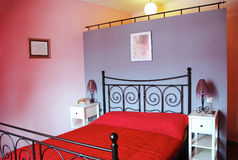 Modern bedroom in pink tinge Stock Photography