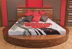 Modern bedroom with red roses Stock Photos
