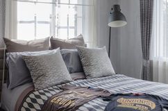 Modern bedroom with shirts on bed Royalty Free Stock Photography