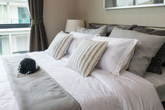 Modern bedroom with striped pillows Stock Photos