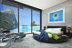 Modern bedroom with a view of a magnificent seaside ocean cove. Photo realistic 3d rendering Royalty Free Stock Photos