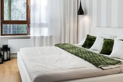 Modern bedroom in white finishing. And wooden floor Stock Images