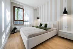 Modern bedroom in white finishing. And wooden floor Royalty Free Stock Photos