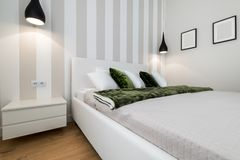 Modern bedroom in white finishing. And wooden floor Royalty Free Stock Photo
