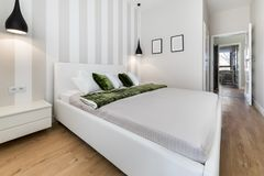 Modern bedroom in white finishing. And wooden floor Stock Photography