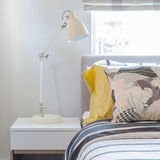 Modern bedroom with white lamp on white wooden table side Royalty Free Stock Photos