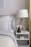 Modern bedroom with wood lamp on table Royalty Free Stock Photo