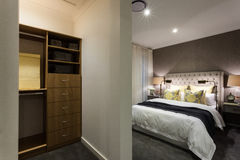 Modern bedroom and wooden cupboard area view at night Royalty Free Stock Photo