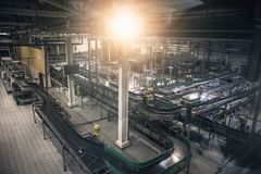Modern beer factory, brewery concept. Steel empty conveyor and pipes for beer production. Industrial background. Toned Royalty Free Stock Photos