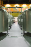 Modern Beer Factory. Rows of steel tanks for the storage beer. Modern Beer Factory. Rows of steel tanks for the storage and fermentation of beer Stock Photos
