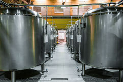 Modern Beer Factory. Rows of steel tanks for the storage beer. Modern Beer Factory. Rows of steel tanks for the storage and fermentation of beer Stock Image