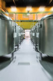 Modern Beer Factory. Rows of steel tanks for the storage beer. Modern Beer Factory. Rows of steel tanks for the storage and fermentation of beer. Motion blur Royalty Free Stock Images