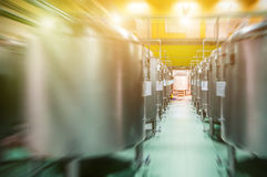 Modern Beer Factory. Rows of steel tanks for the storage beer. Modern Beer Factory. Rows of steel tanks for the storage and fermentation of beer. Spot light and Stock Photography