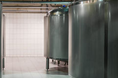 Modern Beer Factory. Small steel tanks for fermentation of beer. Modern Beer Factory. Small steel tanks for storage and fermentation of beer Stock Images