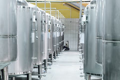 Modern Beer Factory. Small steel tanks for fermentation of beer. Modern Beer Factory. Steel tanks for storage and fermentation of beer Stock Images