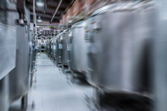 Modern Beer Factory. Small steel tanks for fermentation of beer. Modern Beer Factory. Small steel tanks for storage and fermentation of beer. Motion blur effect Royalty Free Stock Images