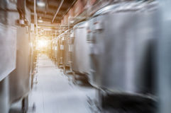 Modern Beer Factory. Small steel tanks for fermentation of beer. Modern Beer Factory. Small steel tanks for storage and fermentation of beer. Motion blur effect Stock Images