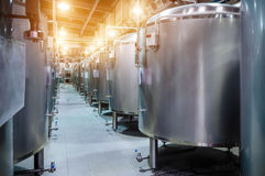 Modern Beer Factory. Small steel tanks for fermentation of beer. Modern Beer Factory. Small steel tanks for storage and fermentation of beer. Spot light effect Stock Image