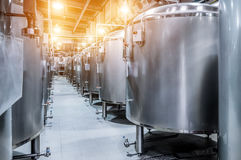Modern Beer Factory. Small steel tanks for fermentation of beer. Modern Beer Factory. Small steel tanks for storage and fermentation of beer. Spot light effect Stock Images